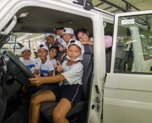 Kids in a car at the RMAA fun learning day