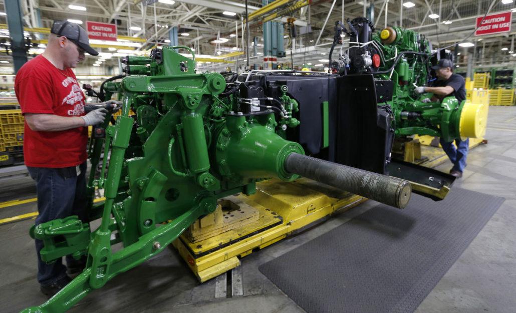 The John Deere team building the new 8245R John Deere Tractor